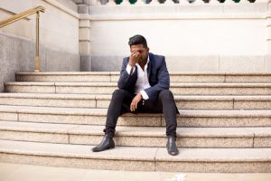 young man sitting on steps